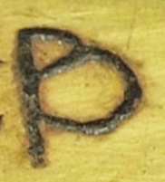 The letter p on the inscribed object StH 550